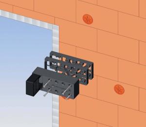 Elemento di montaggio cardini in poliammide rinforzato con fibra di vetro per persiane e scuroni da installare su rivestimenti a cappotto. Produzione Esinplast