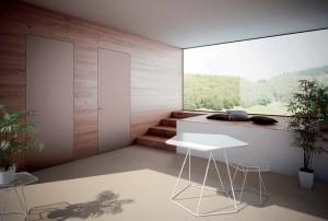 La porta a filo muro costituisce una apprezzabile e versatile soluzione per le esigenze di essenzialità degli spazi contemporanei. In foto una proposta Henry Glass